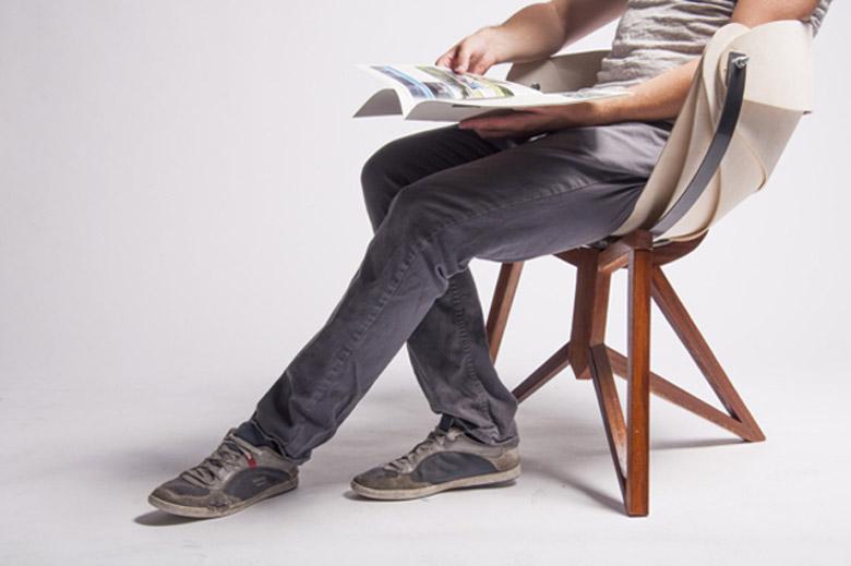 Man sitting on the Globe Chair by Michiel van Gadeldonk