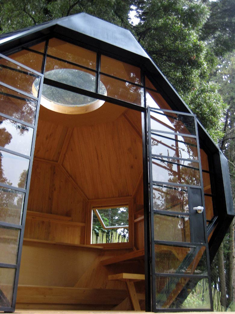 Glass door of the Habitable Polyhedron Garden Office by Manuel Villa