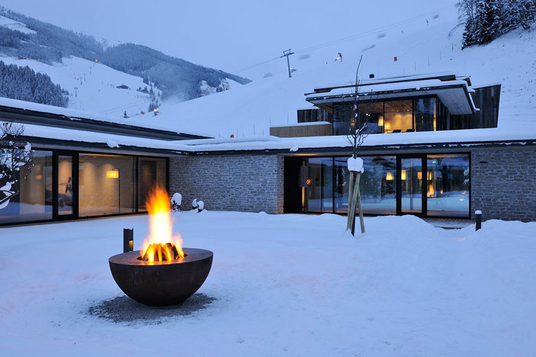 Fire pit at the Hotel Wiesergut in Hinterglemm Austria by Gogl Architekten