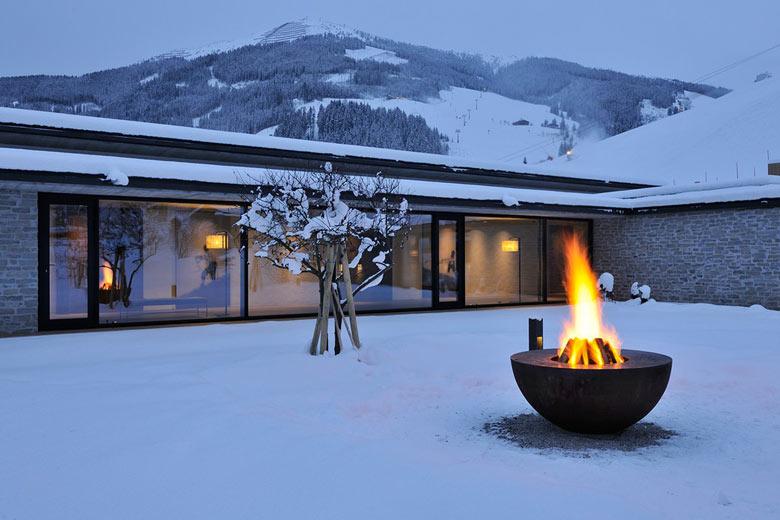Outdoor fire pit at the Hotel Wiesergut in Hinterglemm Austria by Gogl Architekten