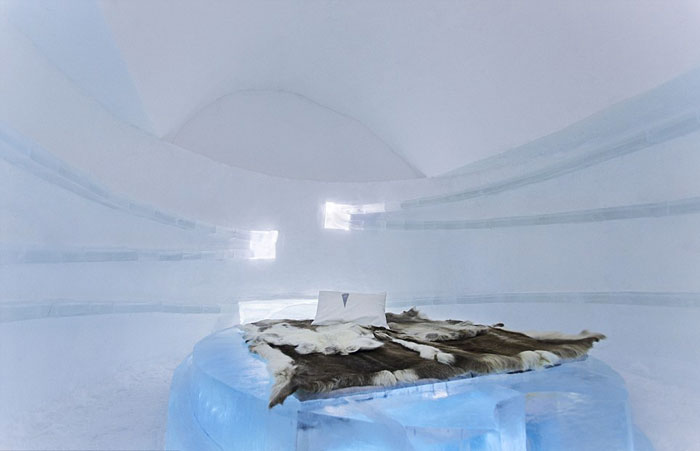 Bed made of ice at the Icehotel An Ice Hotel in Jukkasjarvi Sweden