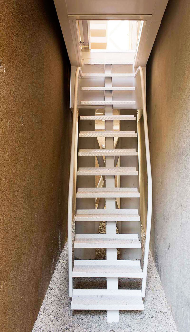Metal staircase of the Keret House the World's Narrowest Home in Warsaw by Jakub Szczesny