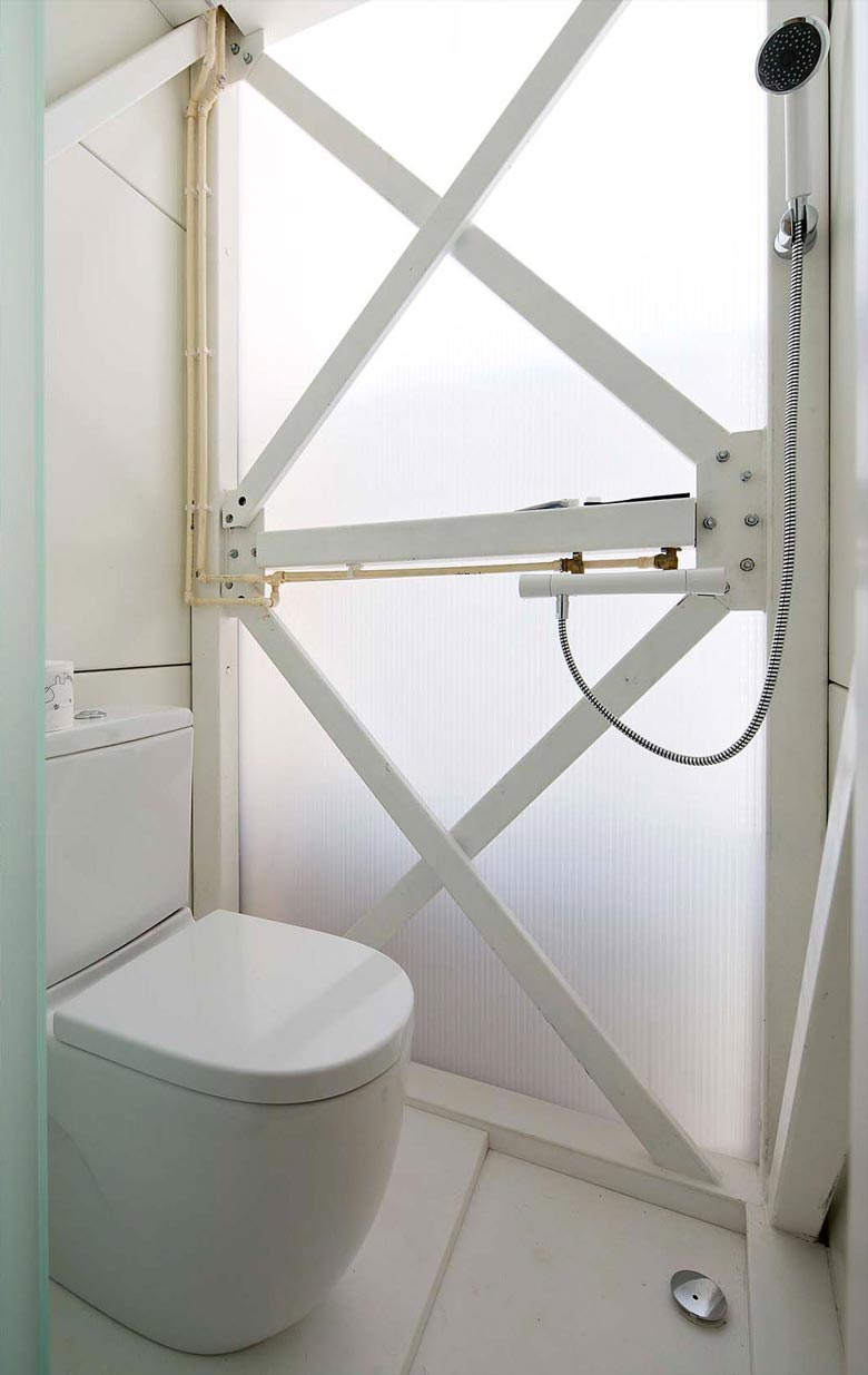Bathroom design of the Keret House the World's Narrowest Home in Warsaw by Jakub Szczesny