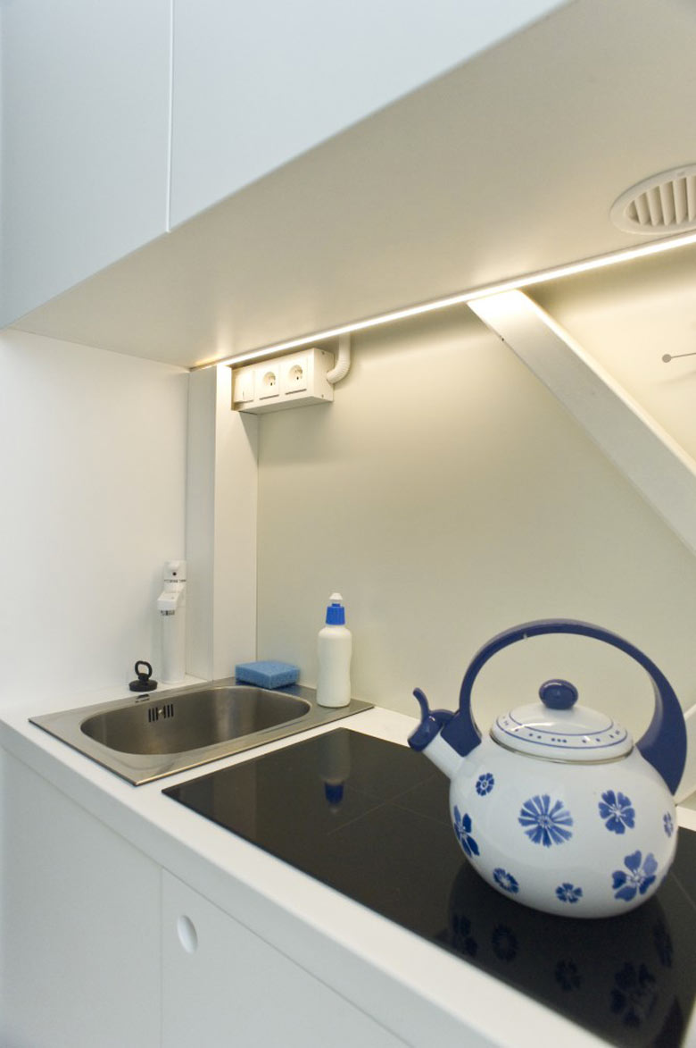 Stove and sink in the kitchen of the Keret House the World's Narrowest Home in Warsaw by Jakub Szczesny