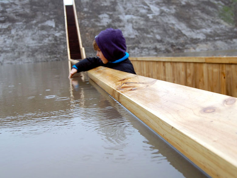 Child reaching out of the Moses Bridge, Sunken Bridge in The Netherlands