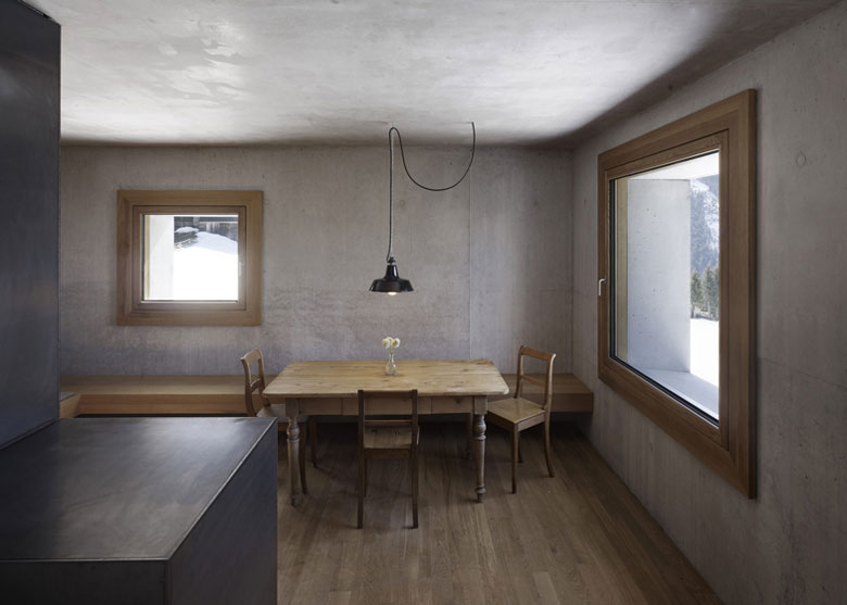 Wooden dining table and chairs at the Mountain Cabin by Marte.Marte in Voralberg Austria