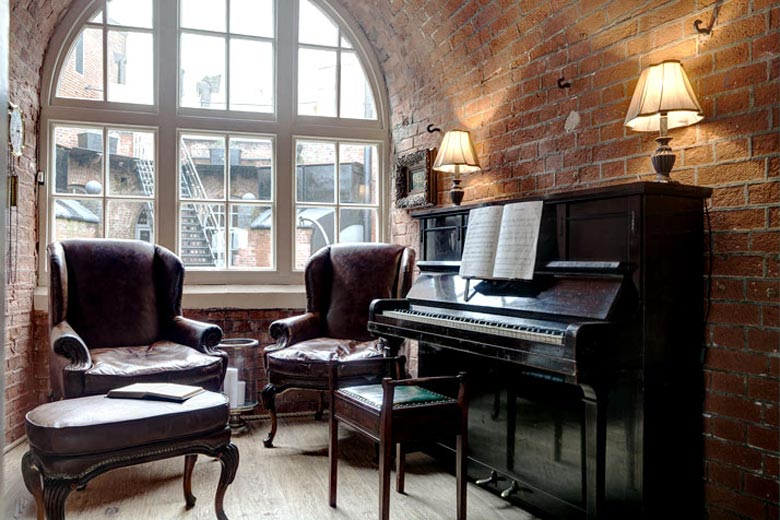 Piano next to a large window at the Spitbank Fort Hotel on the coast of Portsmouth England