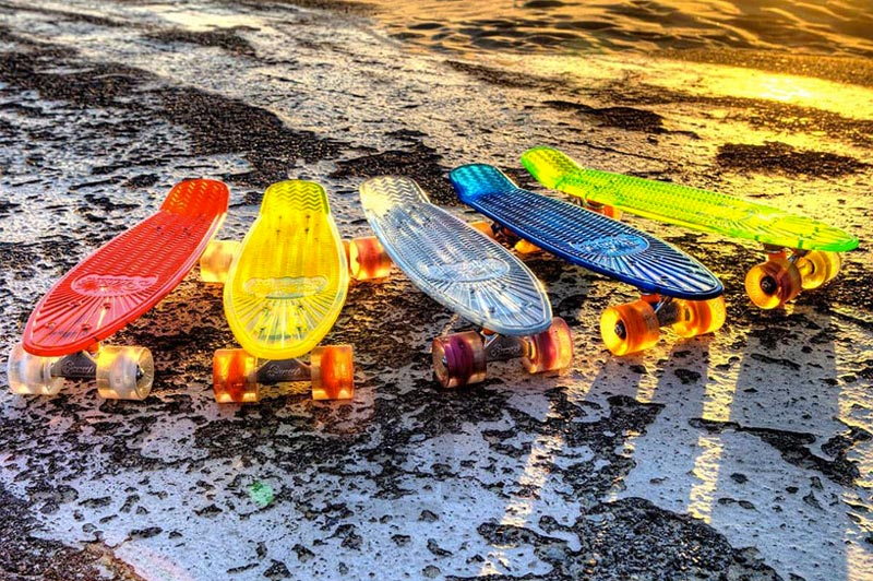 Sunset Skateboards's LED Light Skateboards transparent, green, blue, yellow and red colored side by side