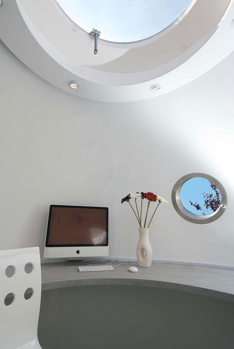 interior design with skylight and window of The Pod Garden Office by Archipod
