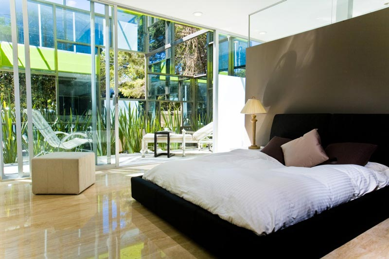 Bedroom at the Trevox 223 Reflective Building by CRAFT Arquitectos
