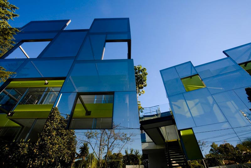 Architecture of the Trevox 223 Reflective Building by CRAFT Arquitectos