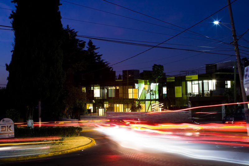 Street view of the Trevox 223 Reflective Building by CRAFT Arquitectos