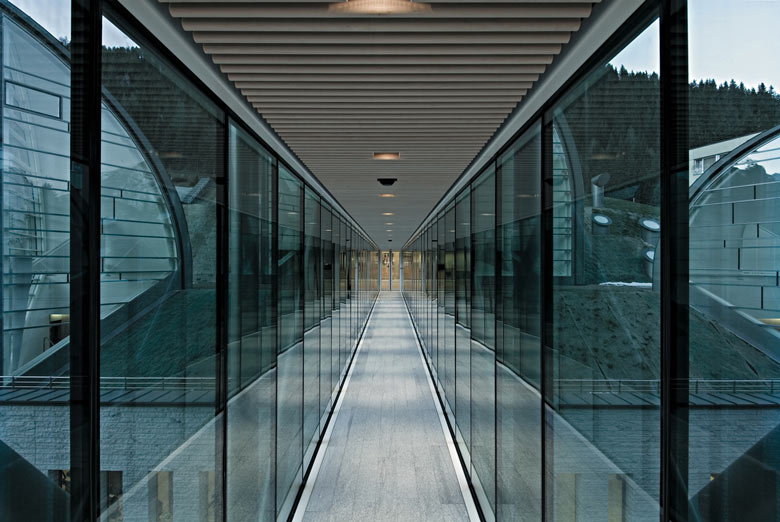 Hallway with glass windows at the Tschuggen Bergoase Wellness Spa Arosa Switzerland Swiss Alps by Mario Botta Architetto