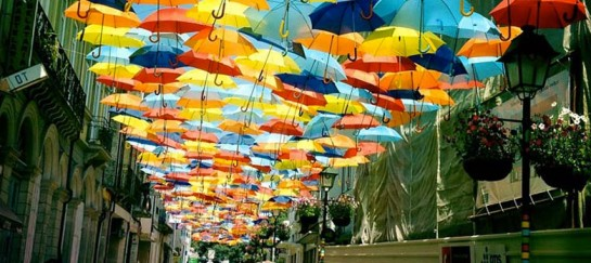 Floating Umbrella Installation in the Streets of Agueda, Portugal