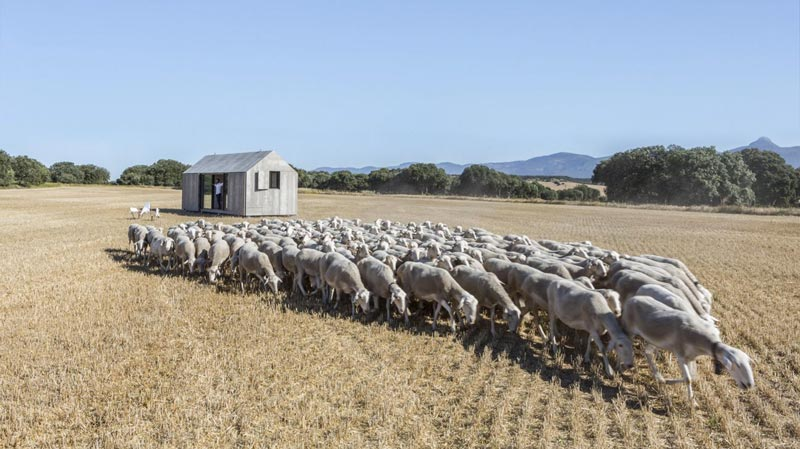 aph80 Portable Concrete Prefab House by Abaton in a field in Spain
