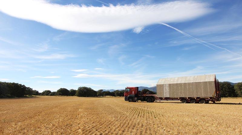 Truck hauling a aph80 Portable Concrete Prefab House by Abaton