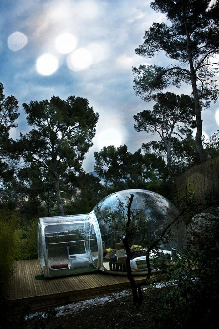 Attrap Reves Bubble Hotel Made of Transparent Tents in nature outdoors