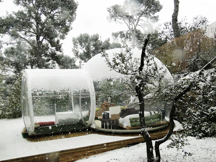 Attrap Reves Bubble Hotel Made of Transparent Tents during winter under a layer of snow