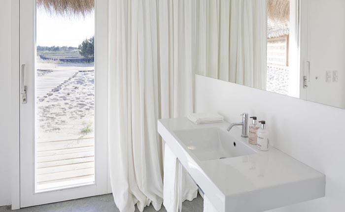 White bathroom design at Casas na Areia in Comporta Portugal