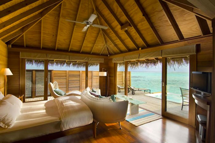Bedroom in a beach villa at the Conrad Maldives Rangali Island Hotel