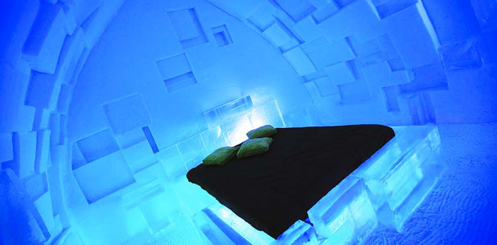 Illuminated bedroom at the Hotel de Glace, An Ice Hotel Quebec City, Canada