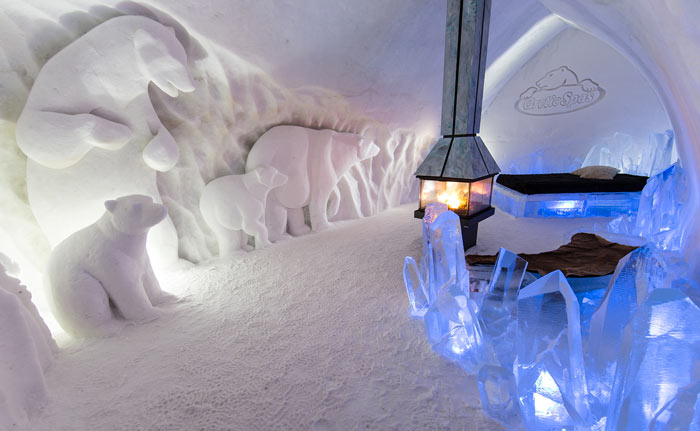 Interior design of a room with a fireplace at the Hotel de Glace, An Ice Hotel Quebec City, Canada