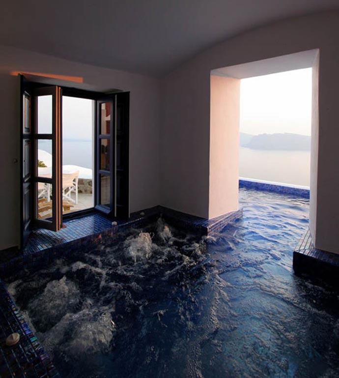 Indoor and outdoor pool at the Ikies Traditional Houses in Santorini