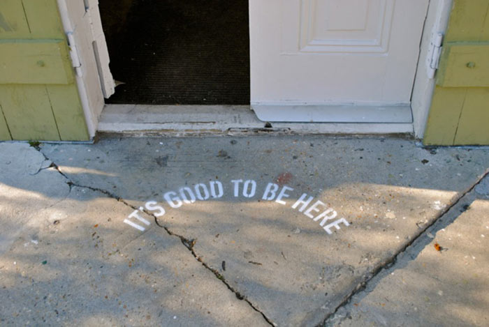 It's Good to be Here by Candy Chang in front of an entrance