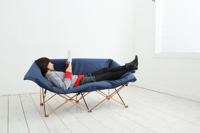 Woman lying down on the KAMP Foldable Sofa KamKam Studio