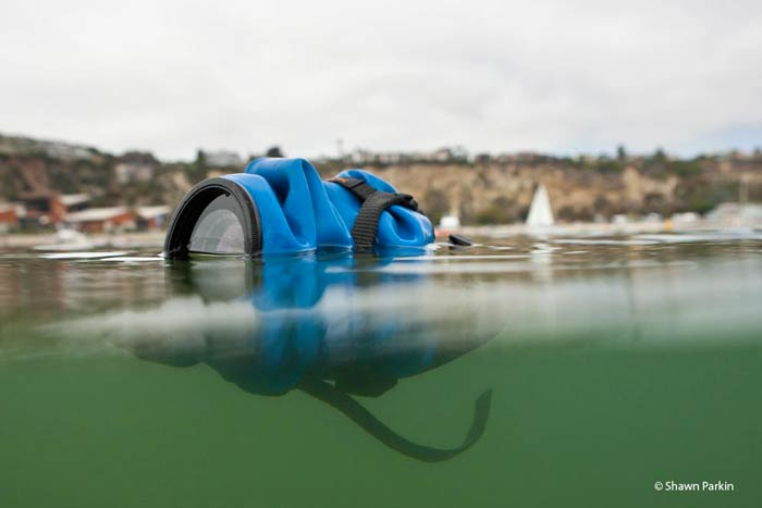 OUTEX SLR Camera Drysuit Kit floating in the sea