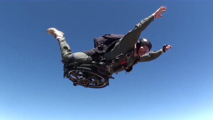 Paratrooper Folding Bicycle by Montague attached to a skydiver