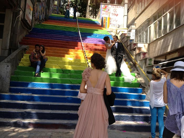 Couple taking wedding photos on the Rainbow Stairs in Istanbul by Huseyin Cetinel
