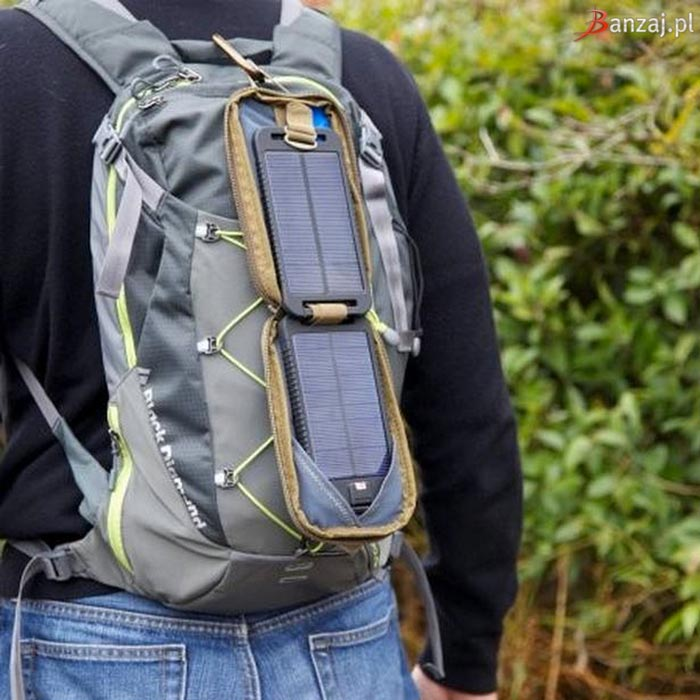 Man using the SolarMonkey Adventurer by Powertraveller attached to his backpack