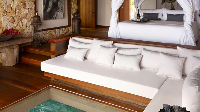 White sofa and white pillows in a spa at the Aerial view of the Song Saa Private Island Resort in Cambodia