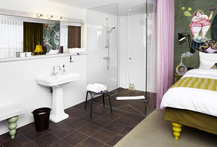 Bathroom design in a room at 25hours Hotel Wien