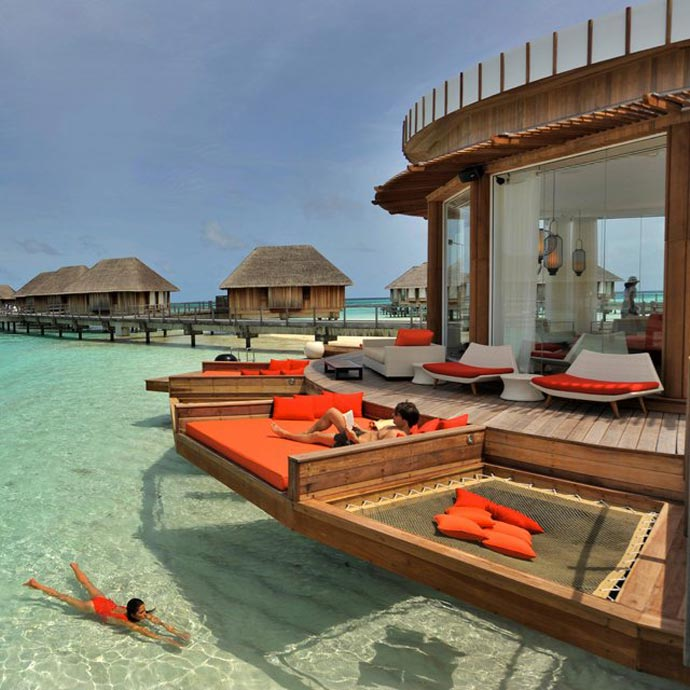 Patio area of a water bungalow at Club Med Maldives