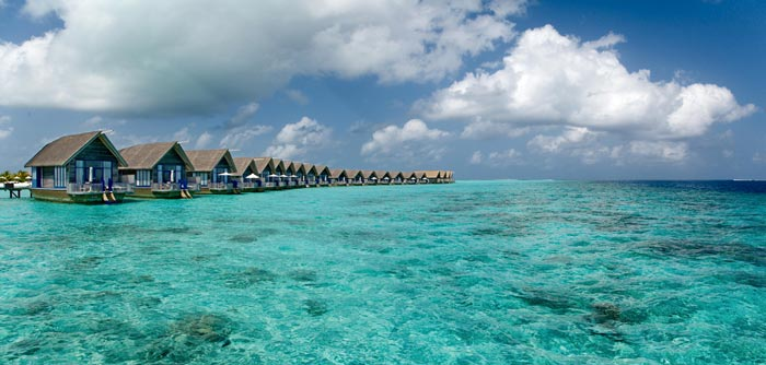 Bungalows on the water at Cocoa Island Resort in The Maldives