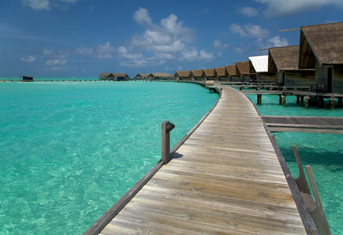 Wooden path over the water at Cocoa Island Resort in The Maldives