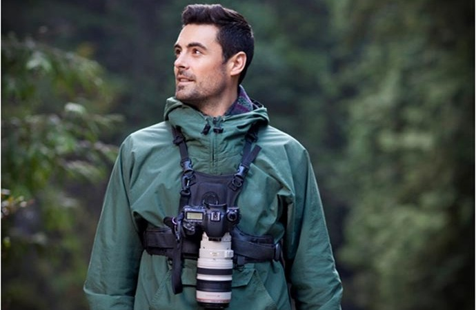 Man using the Cotton Carrier Camera Carrying Vest System