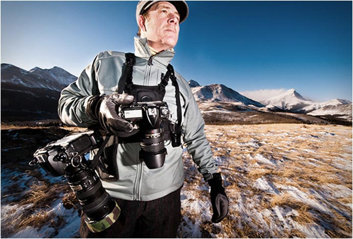 Man using the Cotton Carrier Camera Carrying Vest System for outdoor photography