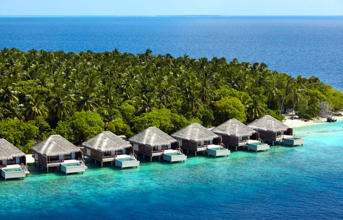 Beach huts at Dusit Thani Maldives Resort in Baa Atoll