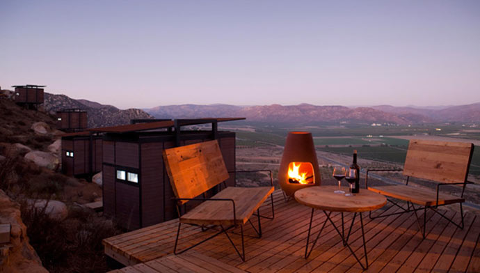 Outside patio with a fireplace and a view of the scenery at ENCUENTRO GUADALUPE ANTIRESORT IN BAJA CALIFORNIA