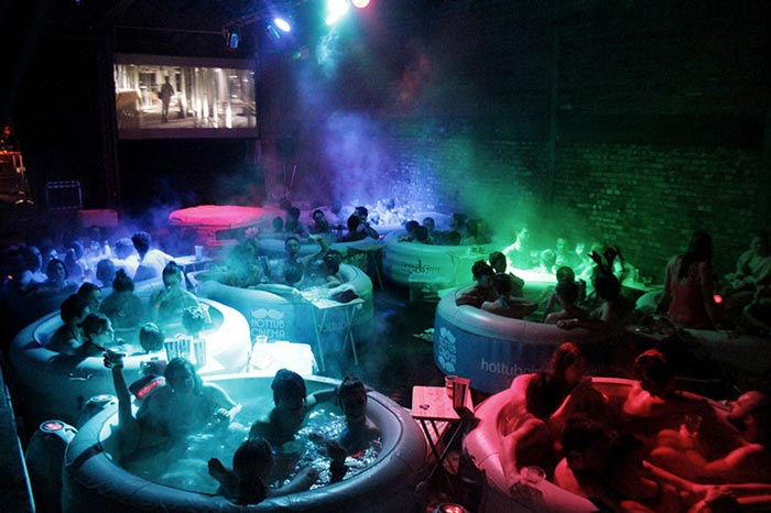 Hot Tub Rooftop Cinema at Rockwell House in London during the night