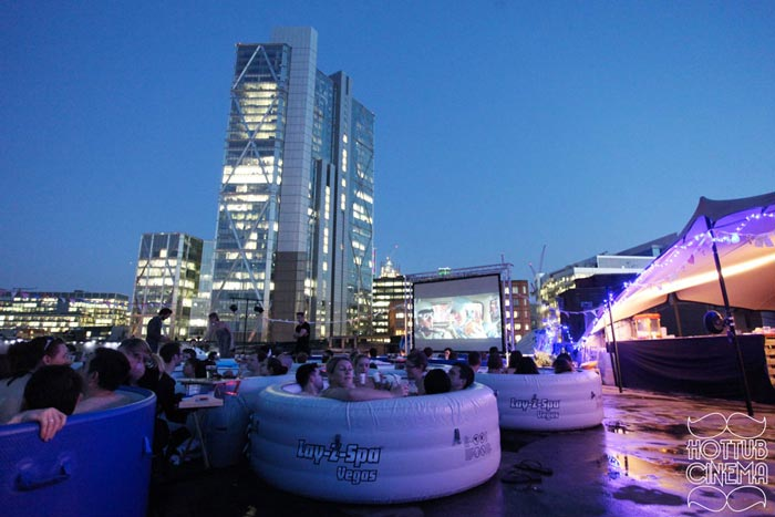 People in Hot Tubs at the Rooftop Cinema at Rockwell House in London
