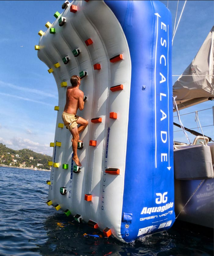 Man climbing an Inflatable Climbing Wall for Yachts