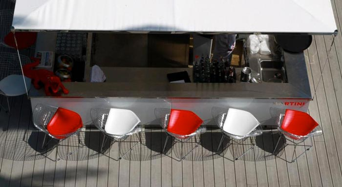 White and red bar chairs at the KUBE Hotel Gassin in Saint-Tropez