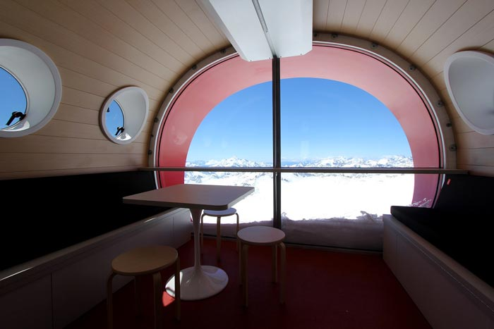 Table and chair with a view of the scenery at LEAPrus 3912 - A Mountain Hotel in Russia