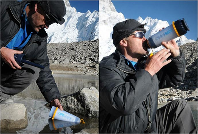 Man using the Lifesaver Bottle - A Portable Water Filter System to purify unclean water
