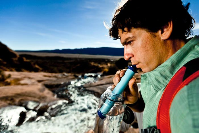 Man using the Lifestraw Portable Water Filtration System