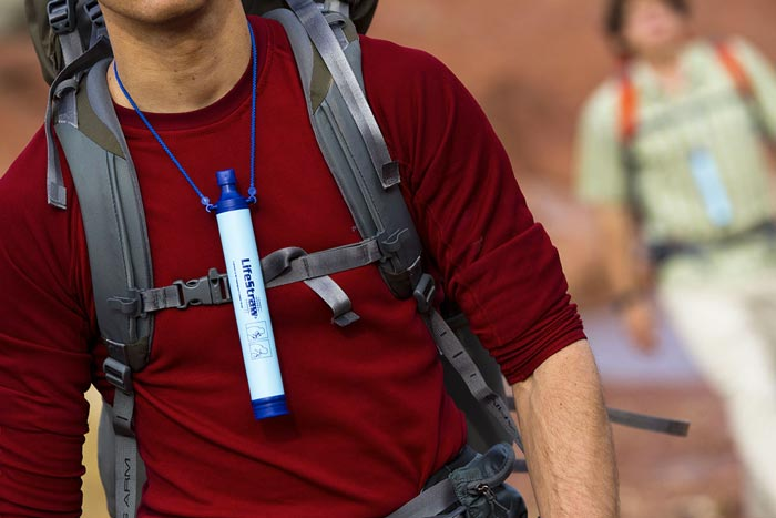 Lifestraw Portable Water Filtration System around a men's neck
